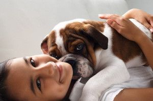Girl Playing with Puppy